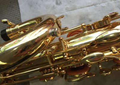 a JoyKey spit valve installed on a baritone saxophone