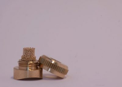 brass casing JoyKey spit valve with the cap off revealing the WaterWick filter