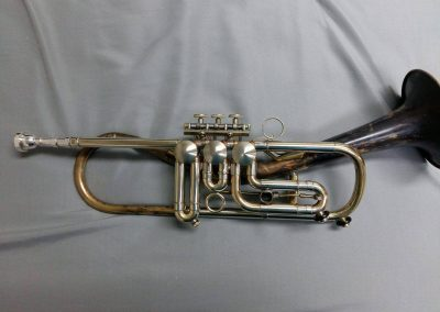 a rotary valved trumpet with a JoyKey spit valve installed on the first valve slide